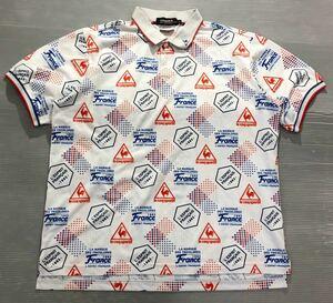 《le coq sportif GOLF ルコックゴルフ》ホワイトライン ロゴ 総柄 半袖 ポロシャツ ホワイト×ブルー×レッド LL