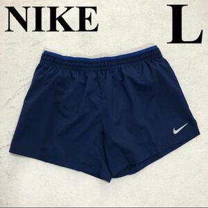 L NIKE レディース スポーツウェア 紺 ナイキフレックスショートパンツ 新品タグ付き ランニングパンツ 13cm トレーニング マラソン
