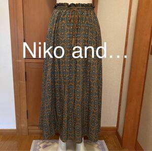 Niko and… ニコアンド ロングスカート 柄スカート タッセル付き